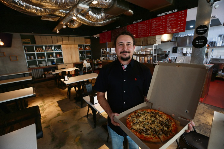 Manager Glaucio Netto with the Mushroom Records pizza. Little C's was in Leederville but it closed down and is now re-opening in The Mezz. Photo: Andrew Ritchie