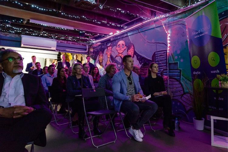 Community News clients listen to Charlie Gearside's presentation on Koala's marketing success.