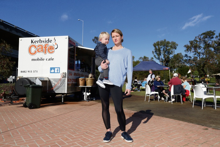Kerbside Café owner Loren Gardner and son William, 16 months, at the popular mobile business, which looks like it will be no more at the Mt Henry Bridge Reserve. Picture: Martin Kennealey.