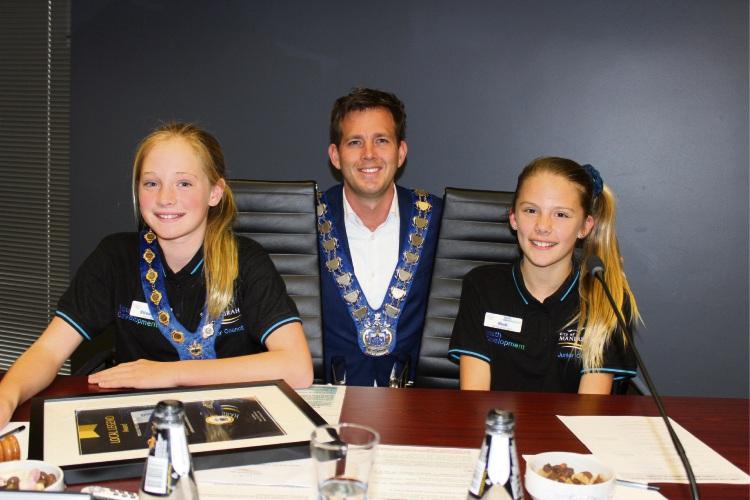 Mayor Rhys Williams with Junior Mayor Elizabeth Eppen-VanDerAa and deputy junior Mayor Binti Christiansen.
