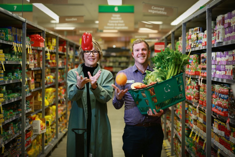 Street Friends founder Michelle Dunlop with Woolworths store manager Ricky Spring. Picture: Andrew Ritchie.
