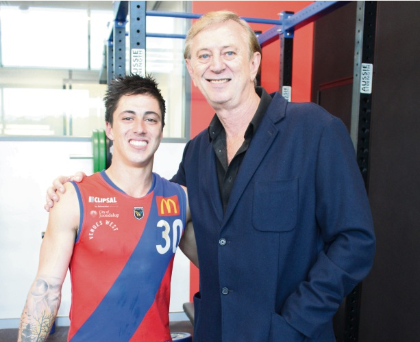 Dennis Cometti congratulates first-gamer Dylan Yem. Picture: J Bianchini