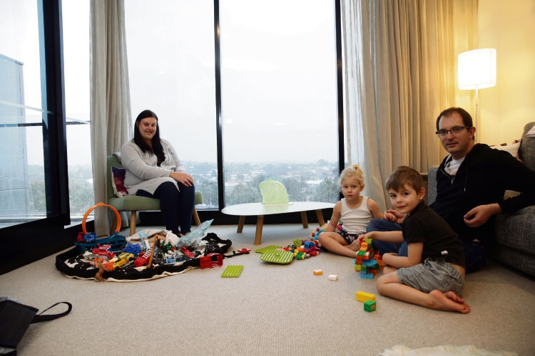 Stephanie and Andrew Nethercote (Wickham) with their children Hayden (4) and Charlotte (3). Photo: Martin Kennealey