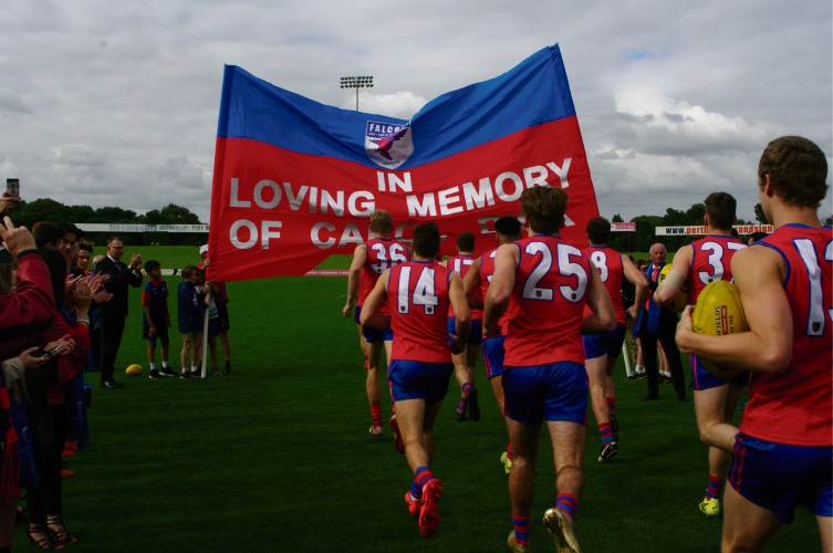 West Perth run through a banner dedicated to long-time Falcons fanatic Carol Bick. Picture: Belinda Taylor