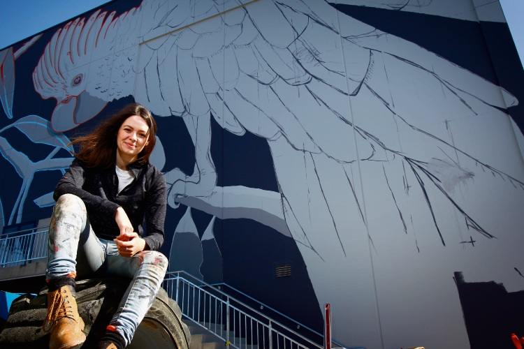 """City of Canning resident and artist Rachelle Dusting (27) in front of her soon-to-be-finished piece """"Close to Home"""" at the brand new Faith Community Church in Willetton Picture: Marie Nirme d485163"""