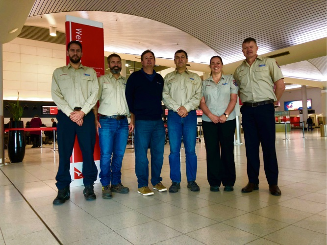 Firefighters Tim Hutton, Luke Bentley, John Fishwick, Peter Bamess, Beverly Gardiner and Leigh Sage at Perth Airport this morning.