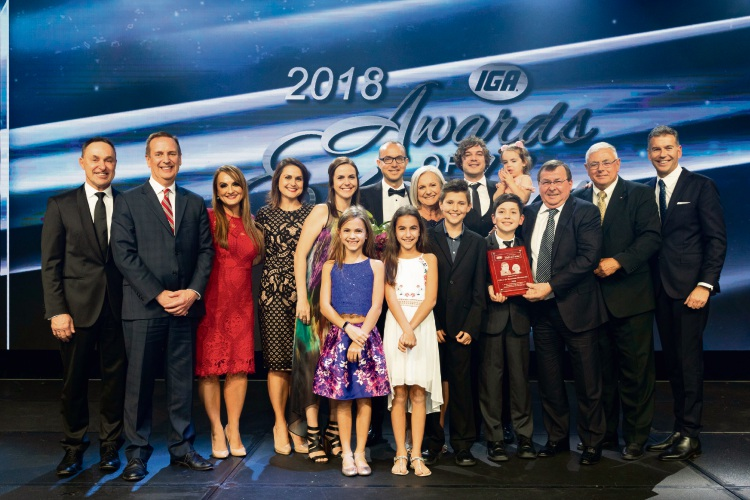 Pearsall IGA celebrates owners Oliver and Roseanne Bertoncini being inducted into the Hall of Fame.