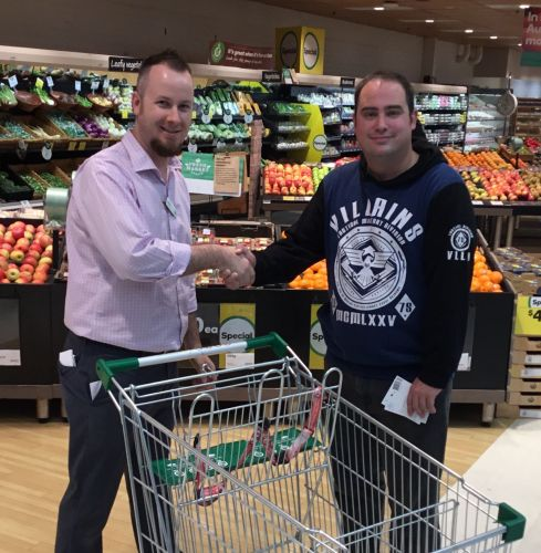 Warnbro resident Scott Leach and Woolworths Kelmscott store manager Chris Briggs.
