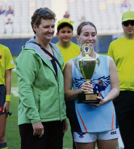 Moore division patron Alison Moore and Mater Dei College girls team captain Breeanna Paice.