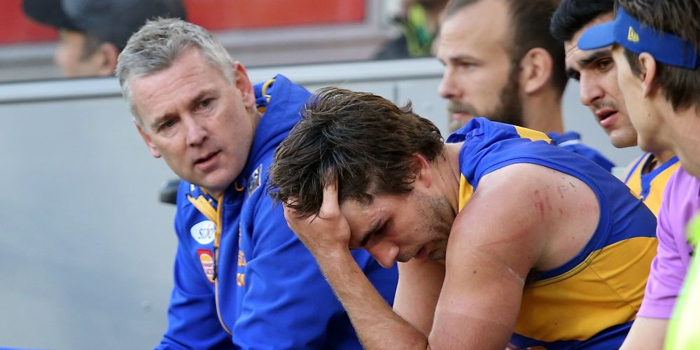 Andrew Gaff of the Eagles looks dejected sitting on the bench during the round 20 AFL match between the West Coast Eagles and the Fremantle Dockers at Optus Stadium on August 5, 2018 in Perth, Australia.  (Photo by Paul Kane/Getty Images)