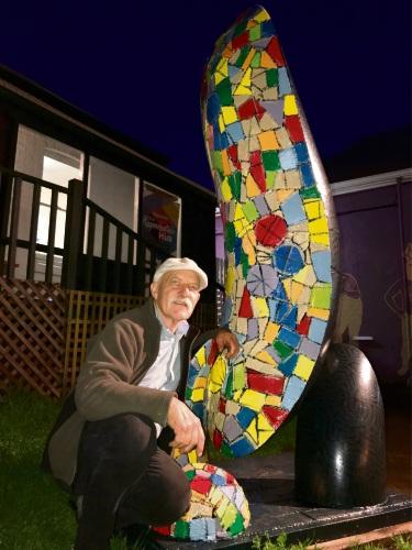 Sculptor Len Zuks with his creation.