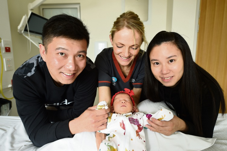 Norman Ng, clinical midwife Lucy Mackey, Katherine Soh with baby Leya. Picture: Jon Hewson.