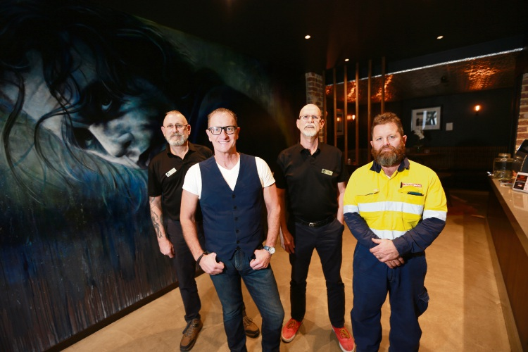 Michael Edwards (Perth Homeless Support Group treasurer), Ian Hale (MD The Backlot), Ron Reid (Perth Homeless Support Group president) and Aaron McGregor (Perth Homeless Support Group vice president) at The Backlot where a Grease singalong fundraiser will be held to help the homeless.