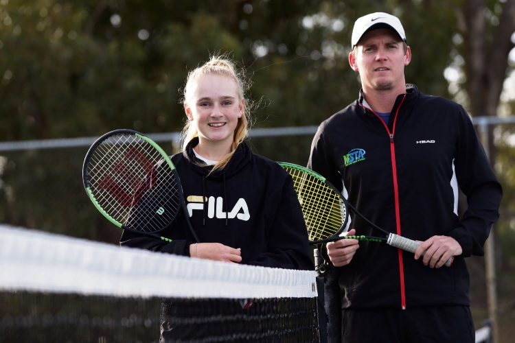 Taylah Preston with her coach Brad Dyer. Photo: Martin Kennealey