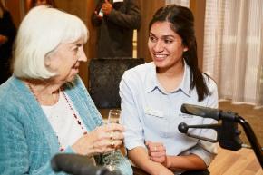 Opal Carine resident June Atkinson and physiotherapist Aditi Chaudhari.