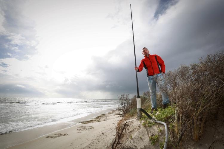 Australian Coastal Radar Facility leader Simone Cosoli has radar aerials toppling into the sea because of Port Beach erosion. Picture: Andrew Ritchie.
