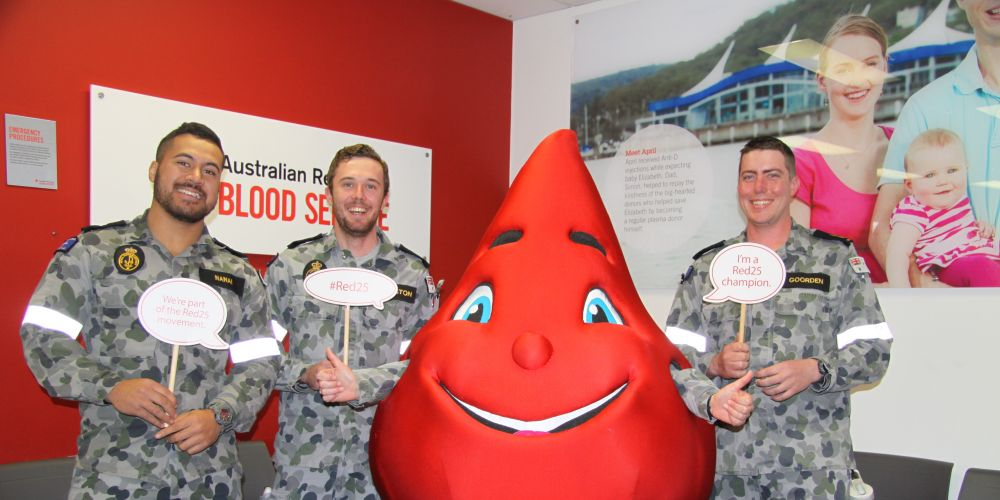 Navy personnel donating blood in Rockingham.