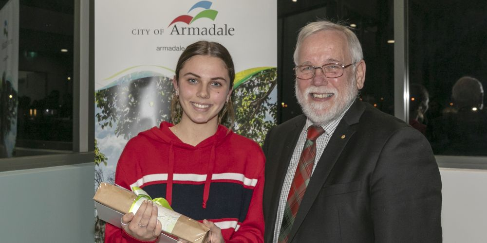 Painting excellence award winner Natalie Ferguson with City of Armadale mayor Henry Zelones.