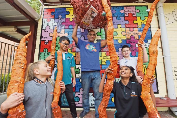 L-R (front): Keanna Jetta and Sharol Naidu, L-R (back and standing) En-Jung Liu, artist Kitsiri De Silva and Brock Walker.