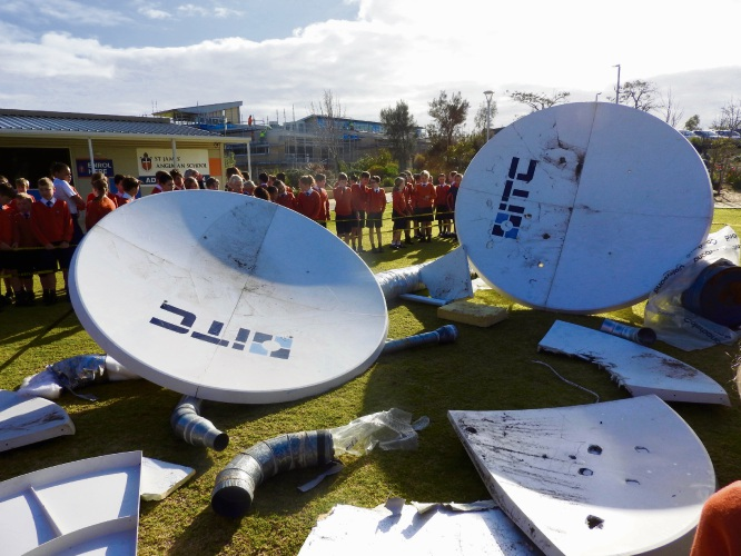 St James' Anglican School students examine a satellite that landed on school grounds.