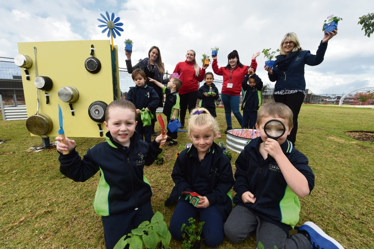 Teacher Kendal Del Fuoco, Hayley Neilsen and Jamie Plenderleith from Bunnings and teacher Linda Starbuck with students Lilly Reid, Lola Fitzsimons and Michael Shorder.