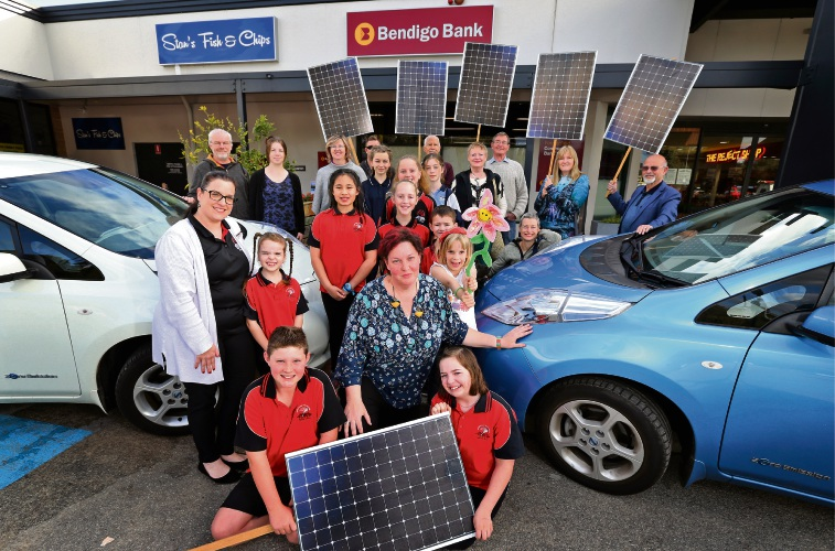 FRONT L-R: Mavrick Bloor (10) of High Wycombe, Adele Standeven (Transition Town Kalamunda) and Scarlett Hunt (10) of Maida Vale, seen here with supporters and electric cars at the Forrestfield Bendigo Bank. Photo: David Baylis