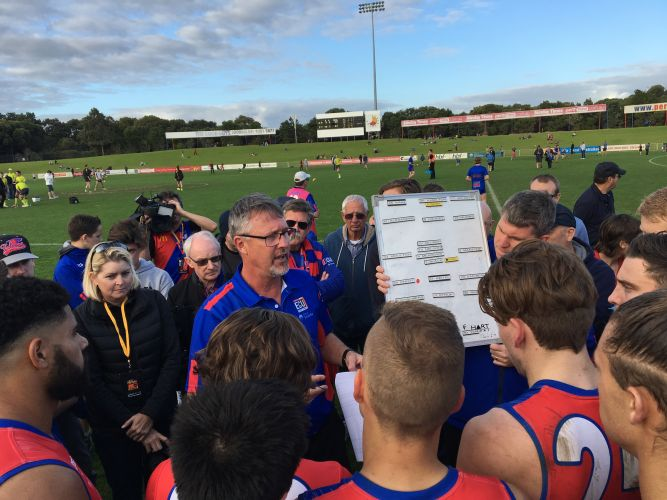 Bill Monaghan addresses the Falcons at Joondalup Arena against Peel Thunder last month. Picture: J Bianchini
