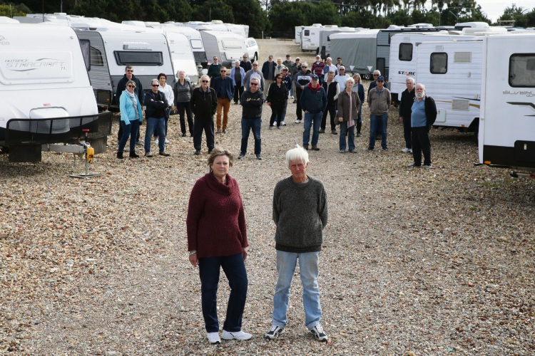 Jandabup residents Jackie Swailes and Monty Shipman with disgruntled caravan owners from across Perth. Photo: Martin Kennealey