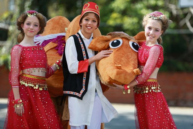 L-R Year 6s from North Cottesloe Primary Margot, Blake and Josie and a camel ahead of their annual production of Ali Baba and the Bongo Bandits. Picture: Andrew Ritchie