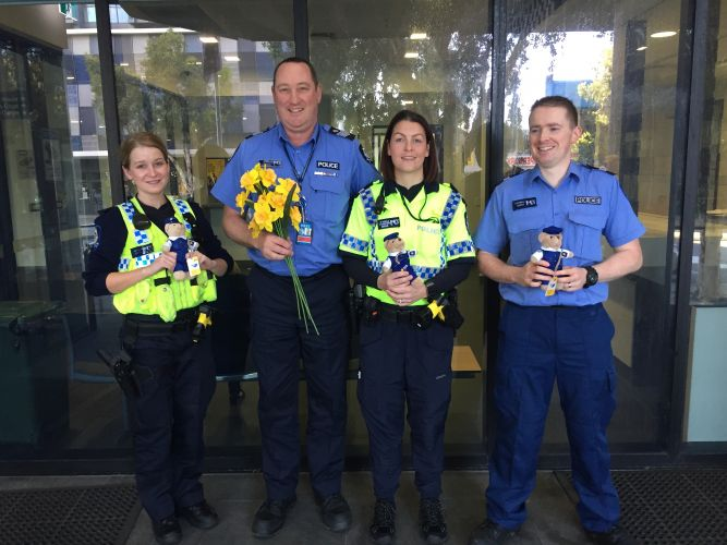 Officers from Perth Police Station with Policeman Dougal bears.