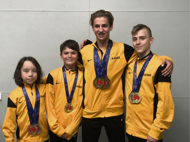 Brian Mackie Karate Life students Teo Roberts, Lucca Barnaba, Jes Bromley and Jamie Kafetzis with their medals.