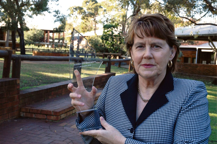 Warwick Senior High School principal Lesley Wintle proudly displays the Australian Education Award.