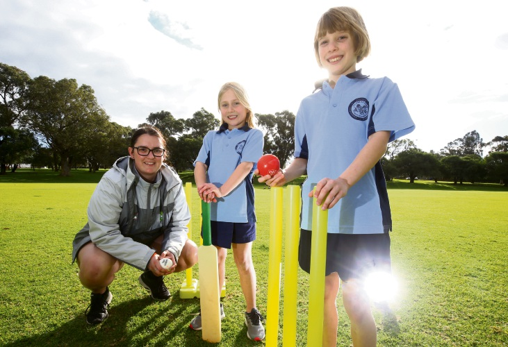 WACA Cricket Manager for the Western Suburbs Leah Morrison with Emma Hyland (8) and Aaliyah Dunbar (9). Picture: Matt Jelonek