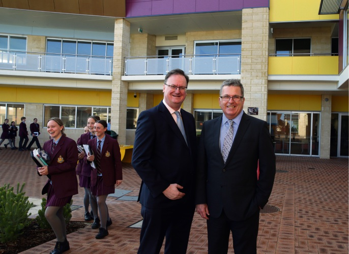 Simon Green (chair of council) with new principal Steven Davies.