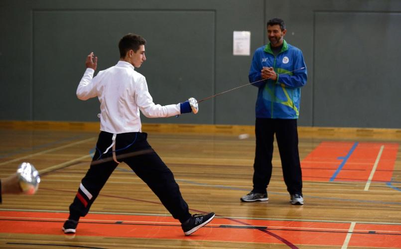 Mitchell Rigney (y10) with Tuko Maia (UWA Fencing Club head coach). Photo: Martin Kennealey