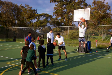 A Fremantle Docker shooting hoops with locals. Photo: supplied