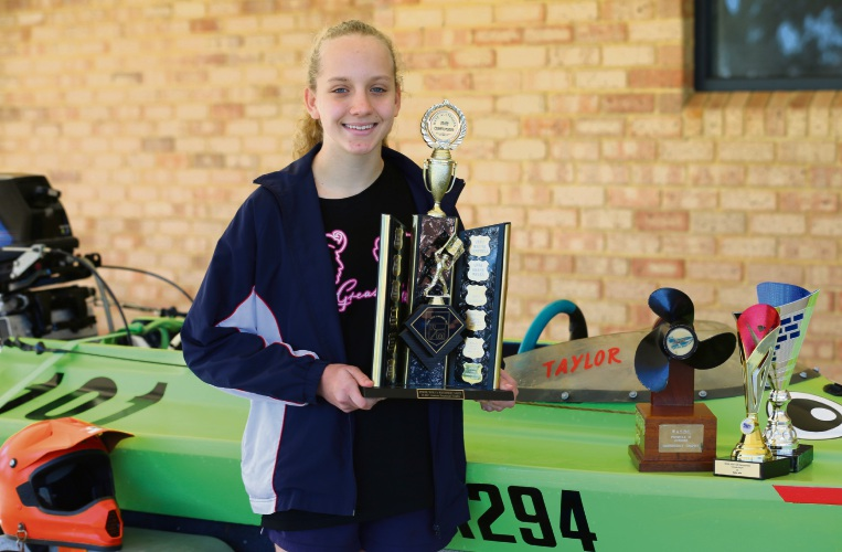 Taylor Jellis with her trophies and speed boat.