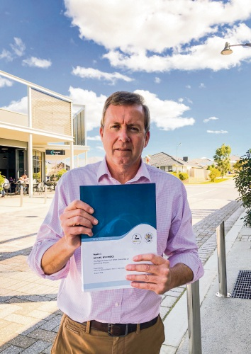 Baldivis MLA Reece Whitby with the report.