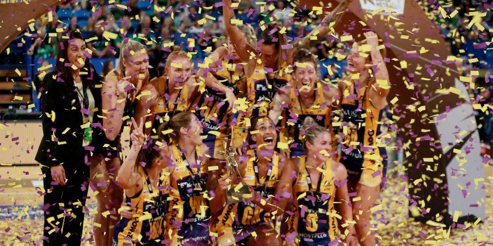 The Sunshine Coast Lightning celebrate winning the grand final.