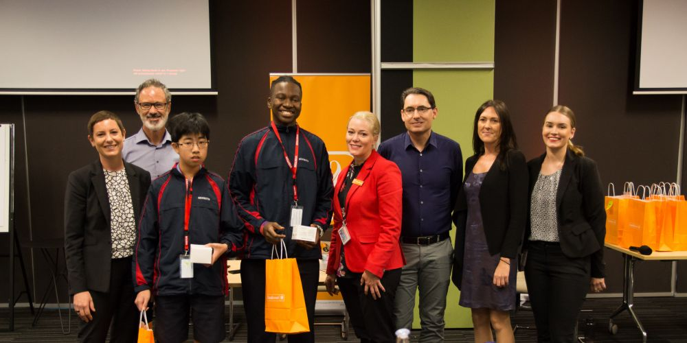 Bankwest Head of Everyday Banking Tribe Louise Tovey, Executive Manager, Enterprise Agility Paul Lewis, winning students Mitchell Ong and Victor Komaiya, Bankwest Chief Operating Officer Shari Cosgriff, General Manager of Software Engineering Paul Graham, Senior Business Assurance Manager Tansy Garlington and the brainchild behind the Junior App Hack Elle Moog.