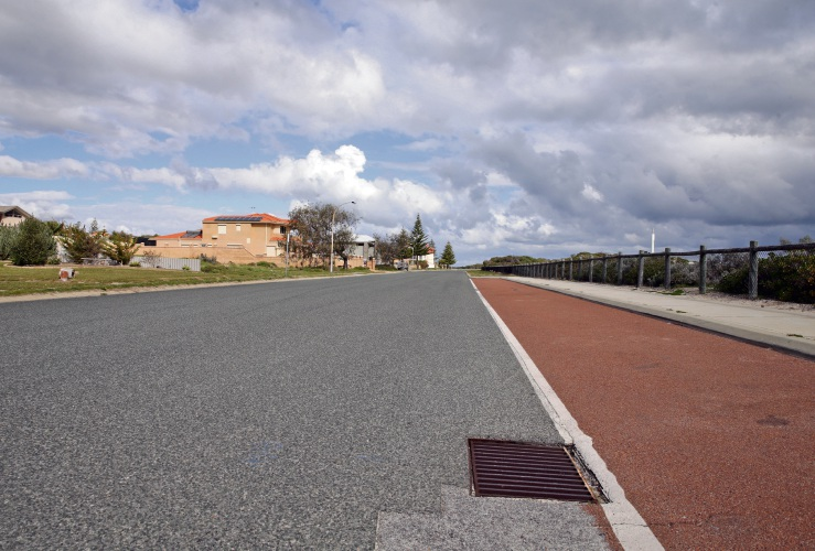 A managed retreat approach could see the City of Wanneroo remove Sovereign Drive and houses fronting it in the future. Picture: Martin Kennealey