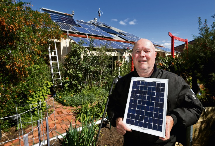 Martin Chape in his backyard with his solar power system. Picture: David Baylis www.communitypix.com.au d486119