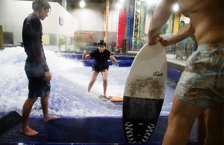 Former Prime Minister Tony Abbott gives Aloha Surfhouse in Joondalup the thumbs up. Picture: Martin Kennealey d486280