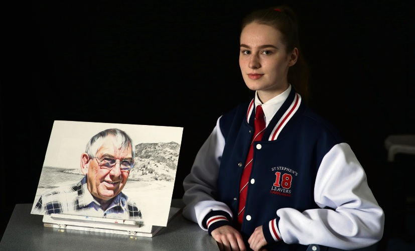 Madeline McAllan with her portrait of her grandfather Mick. Picture: Martin Kennealey.