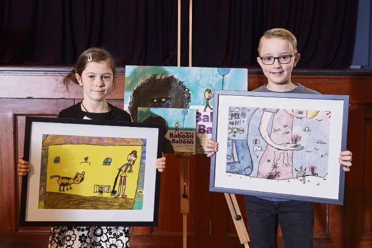 Malia Aitken and Hamilton Dymock with their artwork.