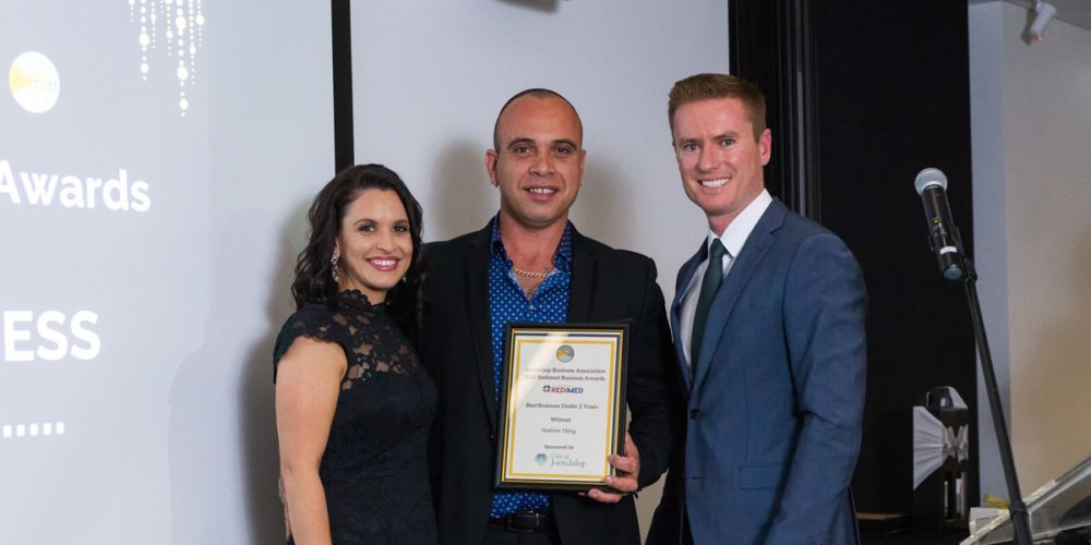 Nicky and Steve Zampogna from Stallion Tiling with Joondalup Mayor Albert Jacob. Picture: Michael Goh Photography