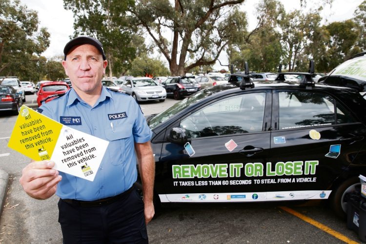 Sergeant Warren Ameduri is teaching tourists and visitors to keep their valuables safe in Kings Park. Picture Andrew Ritchie.