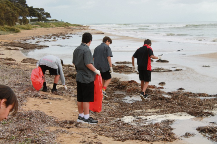 Coodanup Clontarf Academy students help clean up Doddies Beach