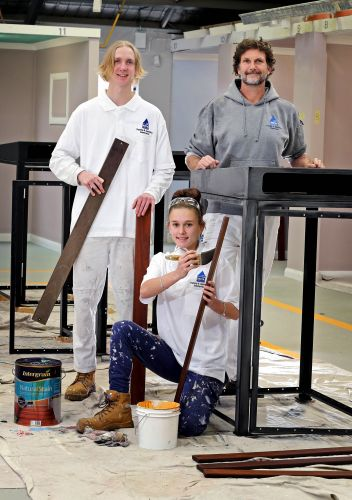 Apprentice Jake Moralee, left rear, and painting trainer Stephen Delaney with apprentice Courtney Heaft, front. Picture: David Baylis www.communitypix.com.au d486236d