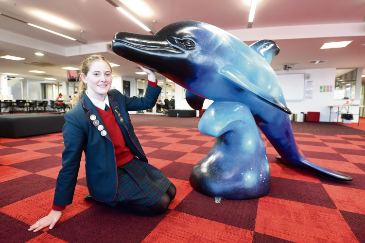 Santa Maria College student Skyla Pengilly with the dolphin We're all made of Stardust, baby. Picture: Jon Hewson